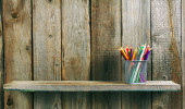 Pencils on a wooden shelf. — Stock Photo
