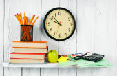 Watches, books and school tools on a wooden shelf. — Stock Photo