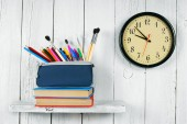 Watches, books and school tools. — Stock Photo