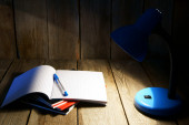 Open writing-book and the fixture. — Stock Photo