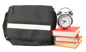 School backpack, books and alarm clock. — Stock Photo