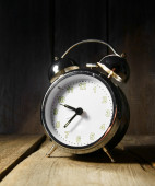 Alarm clock . On wooden background. — Stock Photo
