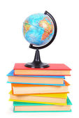 Books and the globe. On white background. — Stock Photo