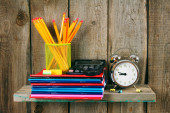 Writing-books, an alarm clock and school tools . — Stock Photo
