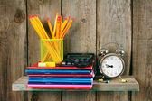 Writing-books, an alarm clock and school tools . — Stock Photo