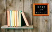 Back to school. Books on wooden shelf and frame. — Stock Photo