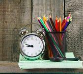 Alarm clock and school accessories . — Zdjęcie stockowe