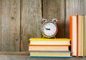 Alarm clock and books. — Stock Photo