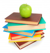 Books and an apple. On white background. — Stock Photo