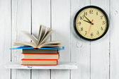 The open book on a wooden shelf and watches. — Stock Photo