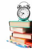 Books, an alarm clock and school tools. — Stok fotoğraf
