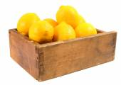 Lemons in an old box — Stock Photo