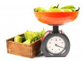 Pepper on scales and in box. — Stock Photo