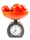Tomatoes on scales. On white background. — Stock Photo