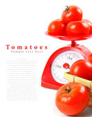 Tomatoes on scales and in a basket. — Stock Photo
