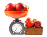Apples on scales and in a box — Stock Photo