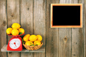 Lemons on scales and in a basket — Stock Photo