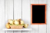 Onions in a basket — Stock Photo