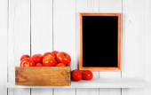 Tomatoes in a box — Stock Photo