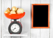 Onions on scales — Stock Photo