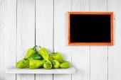 Pepper on a wooden shelf. — Stock Photo