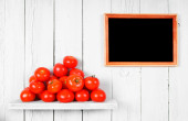 Tomatoes on a wooden shelf. — Stock Photo