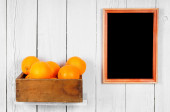 Oranges in a box — Stock Photo