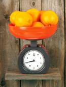 Oranges on scales — Stock Photo