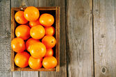 Tangerines in a box — Stock Photo