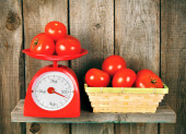 Tomatoes on scales and in a basket — Foto de Stock