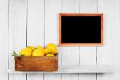 Lemons in a box — Stock Photo