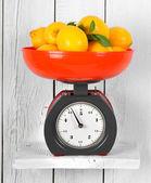 Lemons on scales — Stock Photo