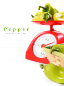 Pepper on scales and in a basket. — Stok fotoğraf