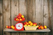 Apricots on scales and in a basket — Stock Photo