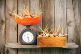 Garlic on scales and in a box — Stock Photo