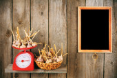 Garlic on scales and in a basket — Stock Photo