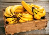Bananas in a box — Stock Photo