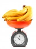 Bananas on scales — Stock Photo
