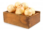 Onions in an old box — Stock Photo