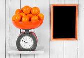 Tangerines on scales — Stock Photo