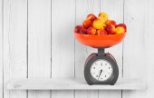 Apricots on scales — Stock Photo