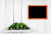 Cucumbers on a wooden shelf. — Stock Photo