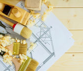 Joiners works. Drawings for building and working tools on wooden background. — Stockfoto