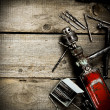 Drill with drills on a wooden background. — Stock Photo #67883803