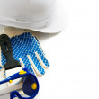 Many working tools - helmet, glove and others on white background. — Stock Photo #67884157