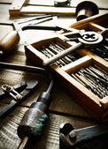 Old drill, compasses, ruler and compasses on a wooden background. — Stock Photo