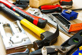 Many working tools on a wooden background. — Stok fotoğraf