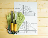 Repair work. Drawings for building and working tools on wooden background. — Stock Photo
