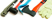 Many working tools - axe, glove and others on white background. — Stock Photo