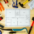 House construction. Drawings for building and many others tools on wooden background. — Stock Photo #67948901